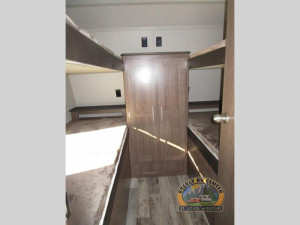 Quad bunk room up front and a rear queen bedroom with a slide in back on the Hideout 32FBTS