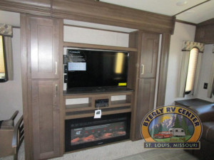 """The Keystone Laredo 330RL features opposing slides and a 40"""" TV located above the fireplace."""