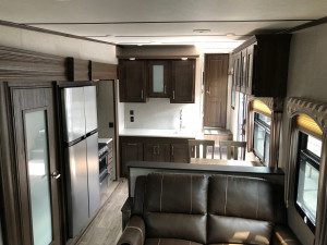 Spacious headroom, full sized appliances and more in the Laredo 342RD at Byerly RV