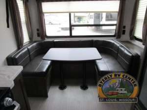 Keystone Passport 216RD features a huge rear window by the U-shaped dinette. See it at Byerly RV in Eureka, MO