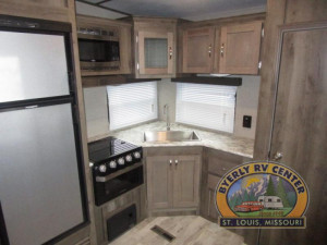 The huge pantry to the right of the kitchen gives you the storage you've been looking for in your RV. See the Keystone Sprinter 27FWML at Byerly RV in St. Louis, Missouri