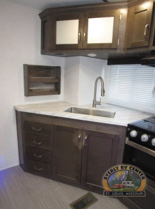 The Keystone Passport 2820BH Travel Trailer features full sized bunks, an exterior kitchen, entertainment center, and great kitchen with updated appliances and counter space