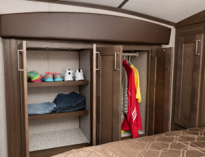 The bedroom wardrobe slide gives you a walk around bed along in this half-ton towable 5th Wheel.  See the 255SRL at Byerly RV in St. Louis, MO